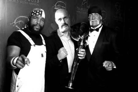 Aquino e Hogan, comemorando o título com B.A. Barakus